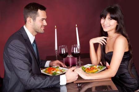 Lovely young couple having romantic dinner in restaurant