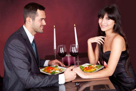 adult dating: Lovely young couple having romantic dinner in restaurant