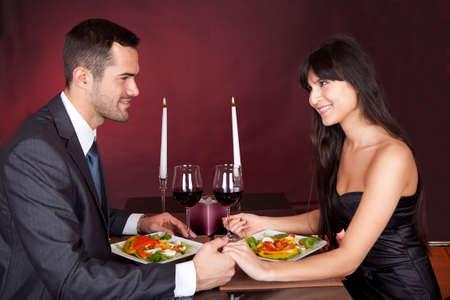 Lovely young couple having romantic dinner in restaurant Stock Photo - 13020349