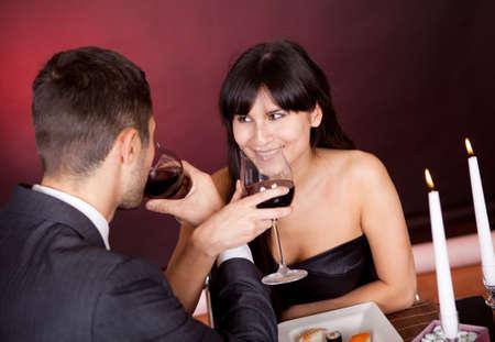 Lovely young couple having romantic dinner in restaurant photo