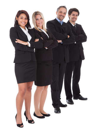 Diverse group of business people confidently standing  together on white background Stock Photo - 13888297