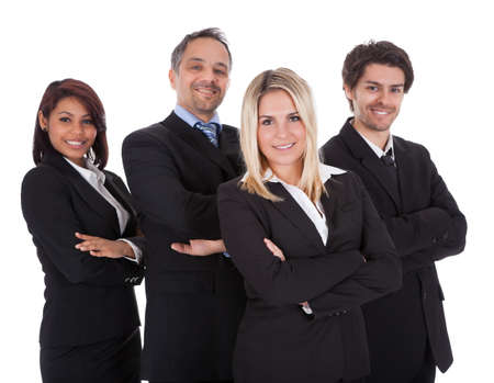 Diverse group of business people confidently standing  together on white background Stock Photo - 13888415