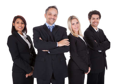 Diverse group of business people confidently standing  together on white background Stock Photo - 13888420