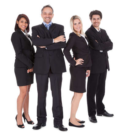 Diverse group of business people confidently standing  together on white background photo