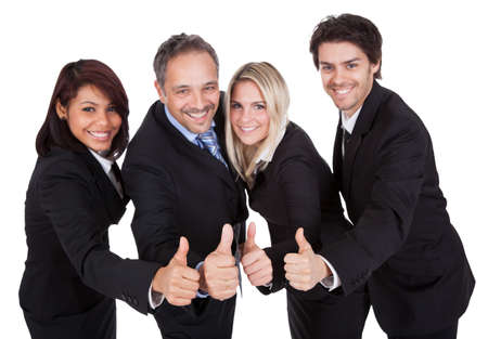 Happy business team celebrating a success with thumbs up on white background Stock Photo - 13888414