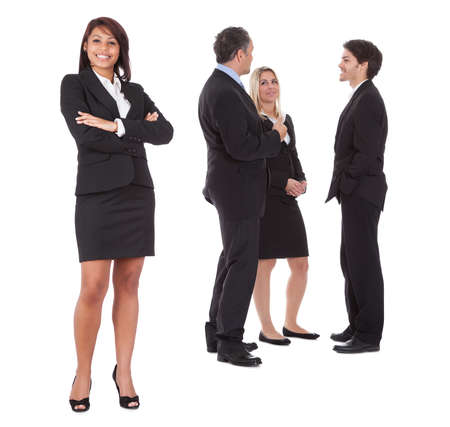 Confident businesswoman with successful group of business people on white background Stock Photo - 13888300