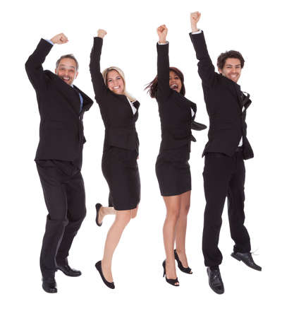 happy people jumping: Portrait of multi ethnic team of business people rejoicing success on white background Stock Photo