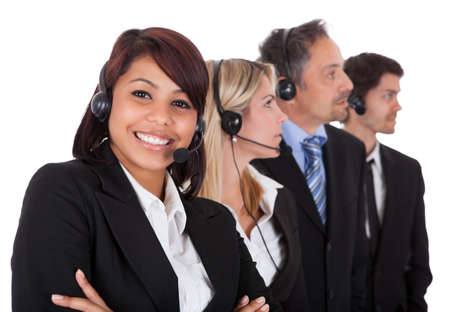 Confident business team with headset standing in a line against white background Stock Photo - 13888434