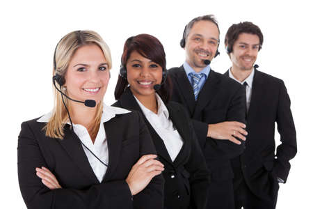 customer assistant: Confident business team with headset standing in a line against white background Stock Photo