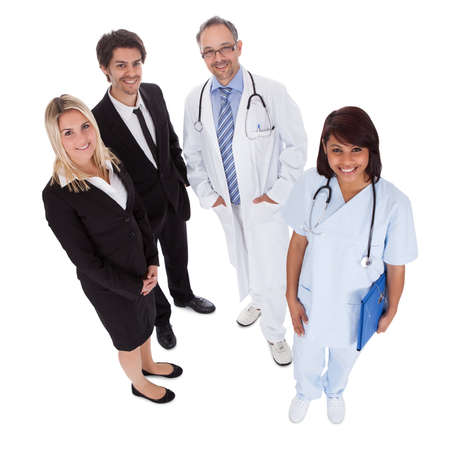 Portrait of businesspeople and medical workers standing on white background photo