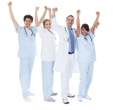 medical worker: Group of doctors celebrating success. Isolated on white Stock Photo