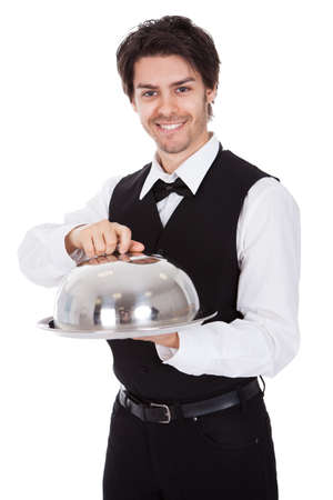 butler: Portrait of a butler with bow tie and tray. Isolated on white