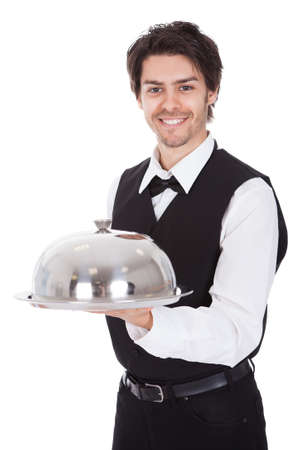 Portrait of a butler with bow tie and tray. Isolated on white Stock Photo - 13888367