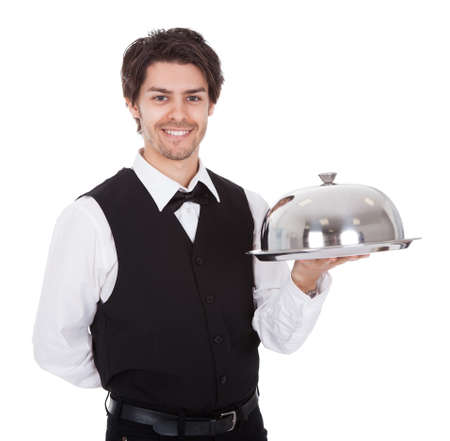 Portrait of a butler with bow tie and tray. Isolated on white Stock Photo - 13888370