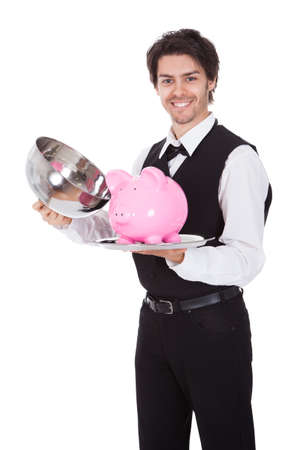 Portrait of a butler with piggybank on a tray. Isolated on white Stock Photo - 13888365