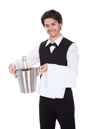 Portrait of a butler with bottle of champagne in a bucket. Isolated on white Stock Photo - 13888371