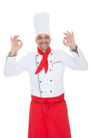 Portrait of a handsome cook. Isolated on white Stock Photo - 13888386