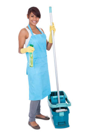chore: Cheerful woman having fun while cleaning. Isolated on white
