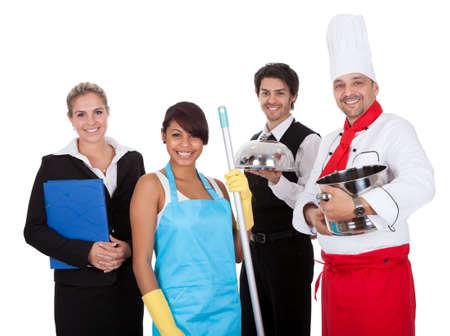 cleaning team: Grupo diverso de trabajadores sonrientes. Aislado en blanco Foto de archivo