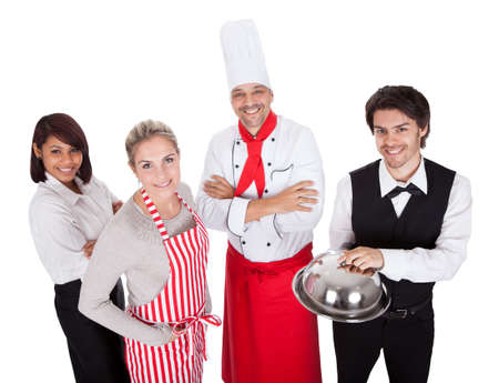 kitchen apron: Group of restaurant chef and waiters. Isolated on white