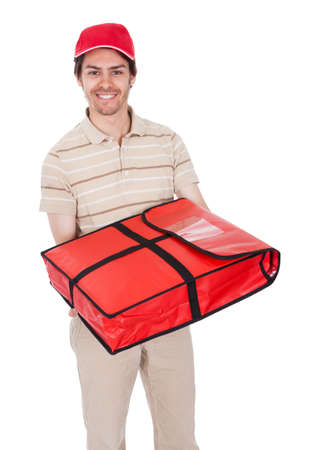 Pizza delivery boy with thermal bag. Isolated on white photo