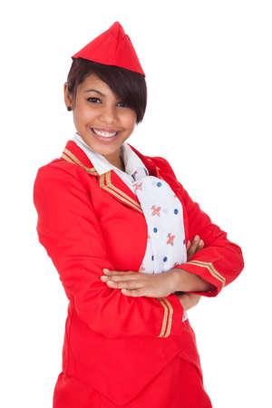 Portrait of young beautiful stewardess. Isolated on white photo