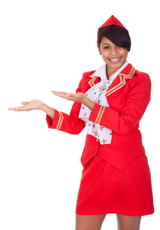air crew: Portrait of young beautiful stewardess. Isolated on white