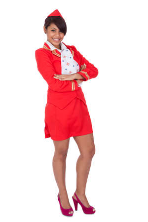 stewardess: Portrait of young beautiful stewardess. Isolated on white