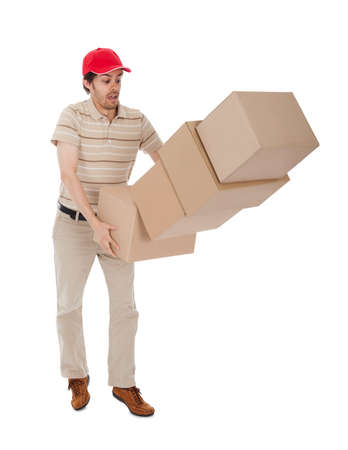Delivery man with falling stack of boxes. Isolated on white photo