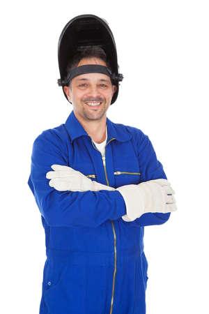 soldador: Retrato de soldador de confianza en la máscara. Aislado en blanco Foto de archivo