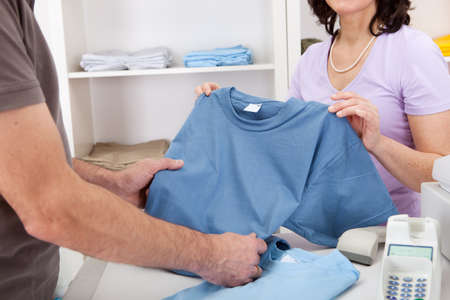 Senior adult men purchasing t-shirt at store photo