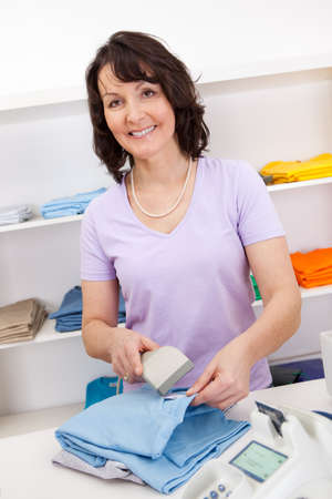 Portrait of cheerful sales person in the retail store Stock Photo - 13907976