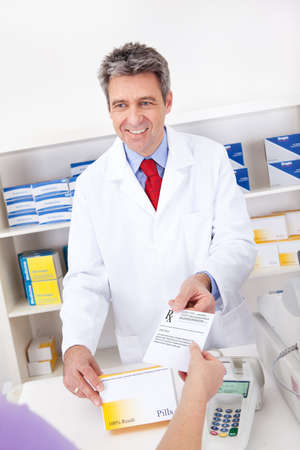 Exchanging prescription for medicine in the drugstore photo