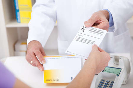 Exchanging prescription for medicine in the drugstore Stock Photo - 13907996