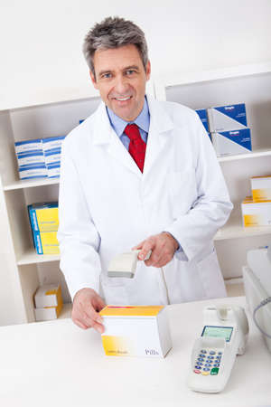 Pharmacist scanning barcode using scanner at drugstore Stock Photo - 13907981