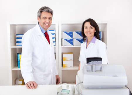 Portrait of two pharmacists at the drugstore smiling Stock Photo - 13907942