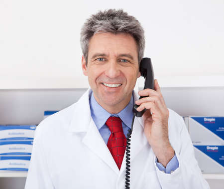 Doctor at the drugstore calling on the phone Stock Photo - 13907963