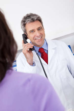 Doctor at the drugstore calling on the phone Stock Photo - 13907964
