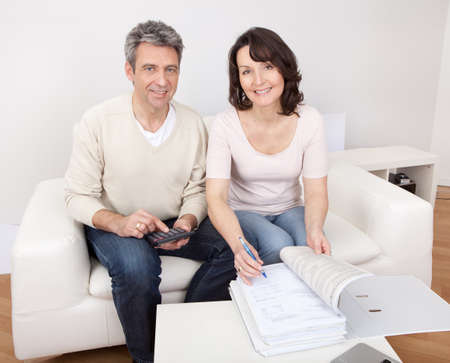 Mature couple doing family finances at home photo