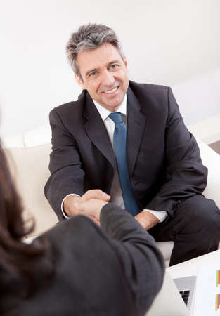 Mature businessman at the hiring interview in the office photo