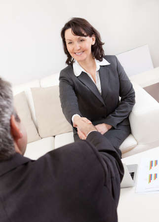 Mature businesswoman at the hiring interview in the office photo