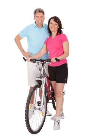 Mature active couple doing sports. Isolated on white photo