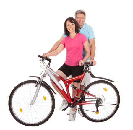 active couple: Mature active couple doing sports. Isolated on white