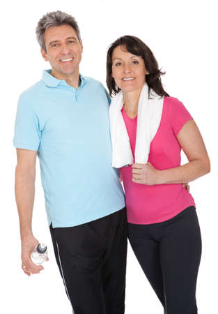 Active mature couple doing fitness. Isolated on white photo