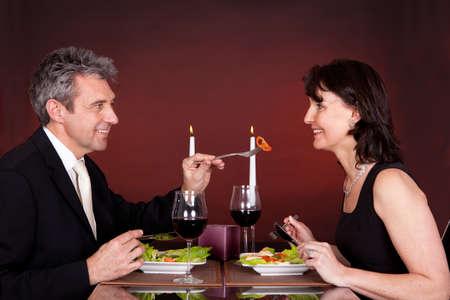 Mature couple having romantic dinner in restaurant photo