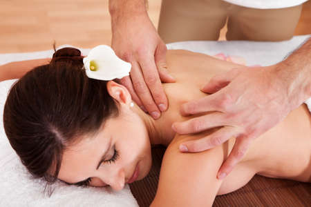 Beautiful young woman getting shoulder massage at spa Stock Photo - 14011792