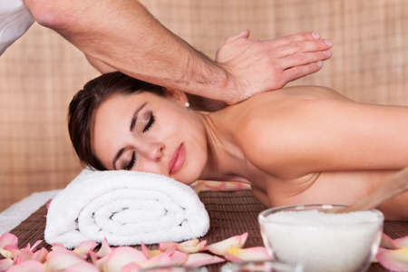 Beautiful young woman getting shoulder massage at spa Stock Photo - 14011849