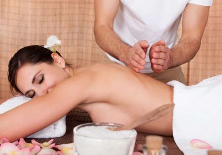 Beautiful young woman getting back massage at spa Stock Photo - 14011647