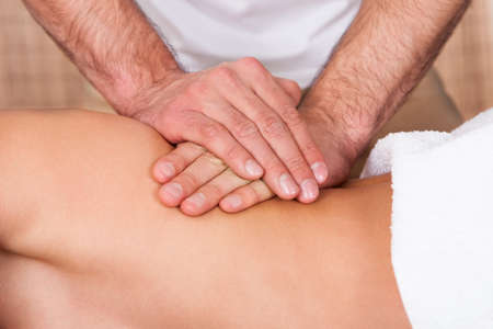 health resort treatment: Beautiful young woman getting back massage at spa Stock Photo