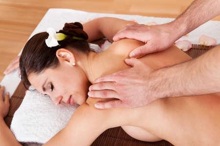 Beautiful young woman getting back massage at spa Stock Photo - 14012031